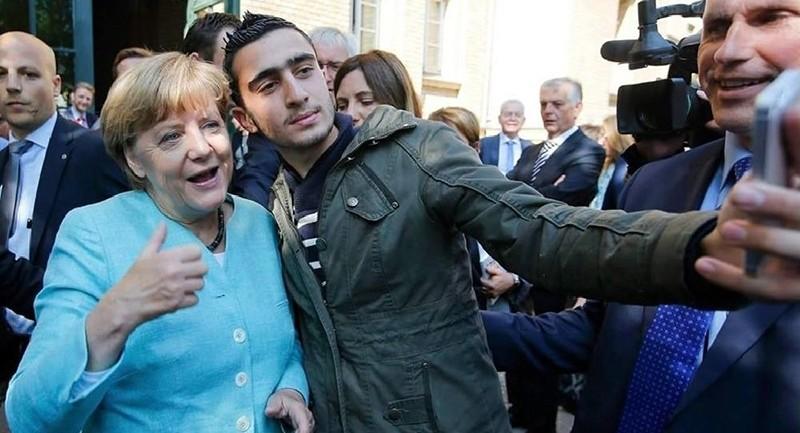 Anas Modamani takes a selfie with Angela Merkel in Berlin in September 2015. (REUTERS Photo)