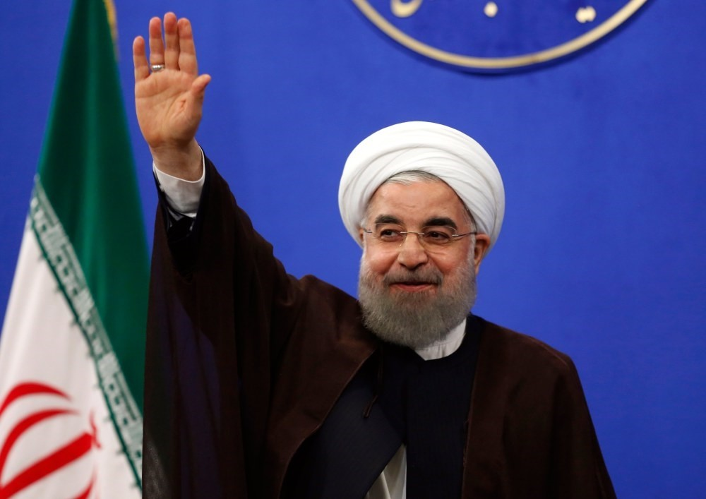 Newly re-elected Iranian President Hassan Rouhani gestures during a televised speech after his presidential election victory, in Tehran, May 20.