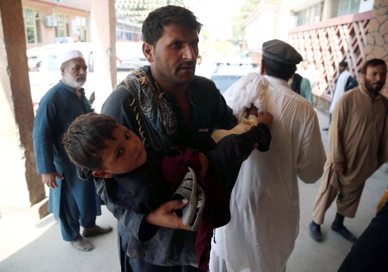A young boy who was injured in suicide bomb blasts which targeted girl's schools, is rushed to a hospital to receive medical attention in Jalalabad, Afghanistan, 11 September 2018. (EPA Photo)