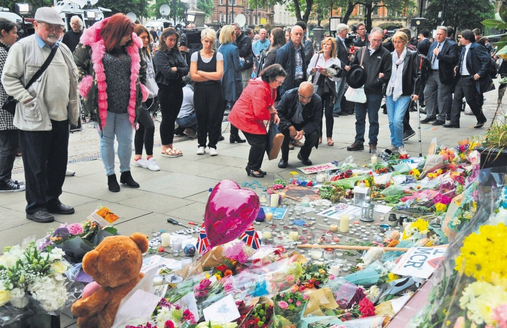 Britons pay their respect to the victims of the Manchester Arena terrorist suicide bombing, May 24.