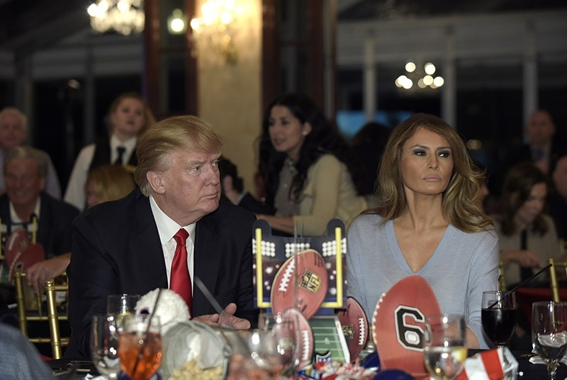 In this Feb. 5, 2017 file photo, President Donald Trump and first lady Melania Trump watch the Super Bowl at a party at Trump International Golf Club in West Palm Beach, Fla. (AP Photo)