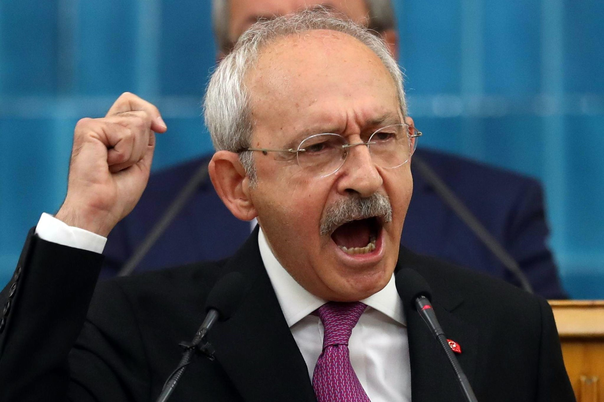 CHP Chairman Kemal Ku0131lu0131u00e7darou011flu gestures as he delivers a speech during his partyu2019s parliamentary group meeting in Ankara, March 27