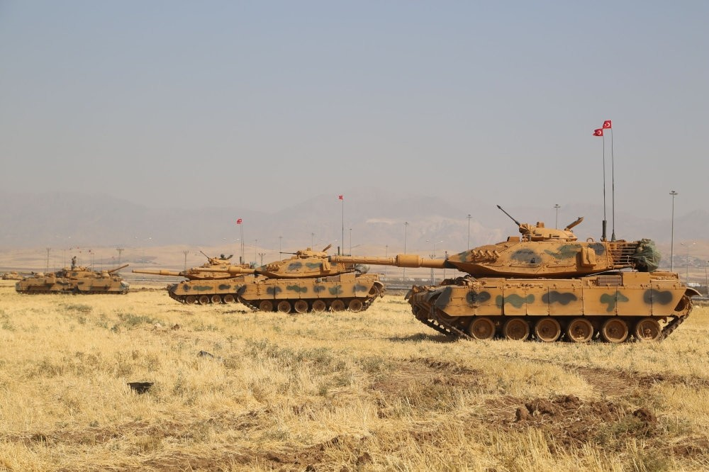 Turkish tanks are seen near the Habur border gate between Turkey and Iraq during a military drill, Sept. 18.