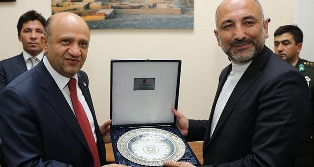 Turkish defense minister Fikri Işık L, National Security Advisor to Ashraf Ghani the President of Afghanistan, Hanif Atmar R in Kabul AA photo