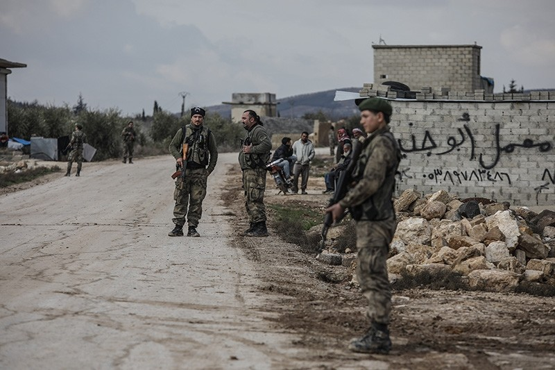 File photo shows members of the Free Syrian Army (FSA) patroling a town in Syria's northwestern Afrin. (IHA Photo)