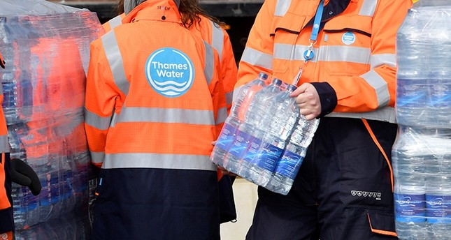 Thames Water operatives collect bottled water for distribution in Hampstead in London, Britain Reuters Photo