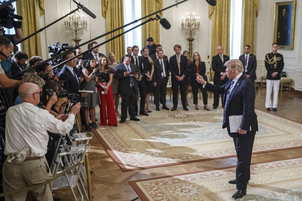 U.S. President Donald Trump responds to questions about the anonymous Op-Ed article published in The New York Times, the White House, Sept 5.