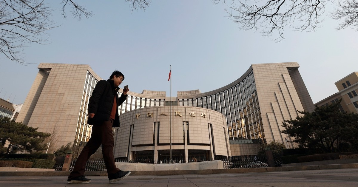A man walks past China's central bank, the People's Bank of China, in Beijing, March 10, 2019.