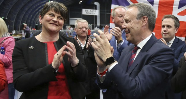 DUP leader Arlene Foster, left, and deputy leader Nigel Dodds cheer as Emma Little Pengelly is elected to the South Belfast constituency on June 9, 2017. (AP Photo)