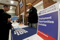 US adds 228K new jobs, unemployment stays at 4.1 pct in November