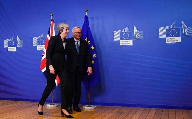 EU Commission President Jean-Claude Juncker and British Prime Minister Theresa May leave after a press briefing during a meeting at the EU Headquarters in Brussels, Nov. 21.