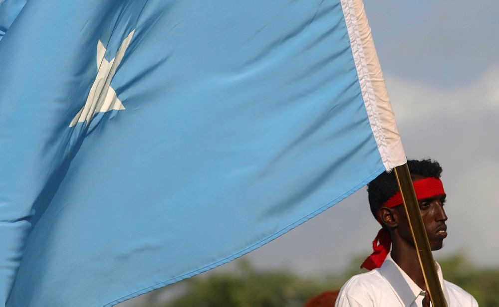 A protester carries the Somali national flag during a demonstration against Al-Shabaab terrorist group after last weekend's explosion at the stadium Koonis, Mogadishu, Somalia, Oct. 18, 2017. (Reuters Photo)