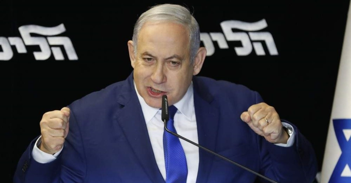Israel's embattled prime minister and leader of the Likud Party, Benjamin Netanyahu, gives a statement after winning a leadership primary that ensures he will lead his right-wing party into a March general election, at the Airport City near Tel Aviv, Dec. 27, 2019.