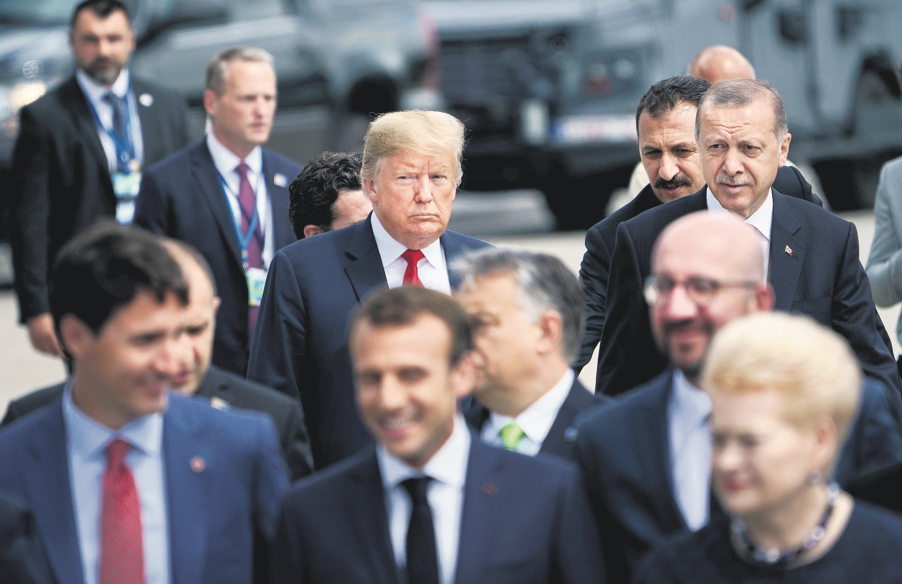 U.S. President Donald Trump (L) and President Recep Tayyip Erdou011fan (R) follow other leaders to a u201cfamily photo u201cduring the summit at NATO headquarters, Brussels, July 11.