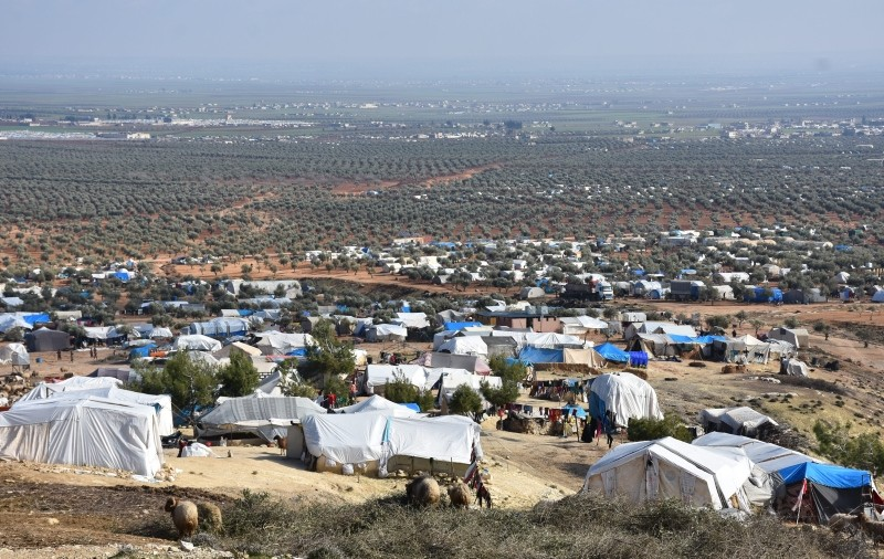 The countryside of the northern Syrian town of Azaz is home to some 250,000 civilians of Arab descent from Tal Rifaat trying to survive in makeshift camps. (AA Photo)