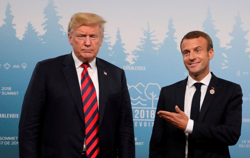 US President Donald Trump and French President Emmanuel Macron hold a meeting on the sidelines of the G7 Summit in La Malbaie, Quebec, Canada. (AFP Photo)