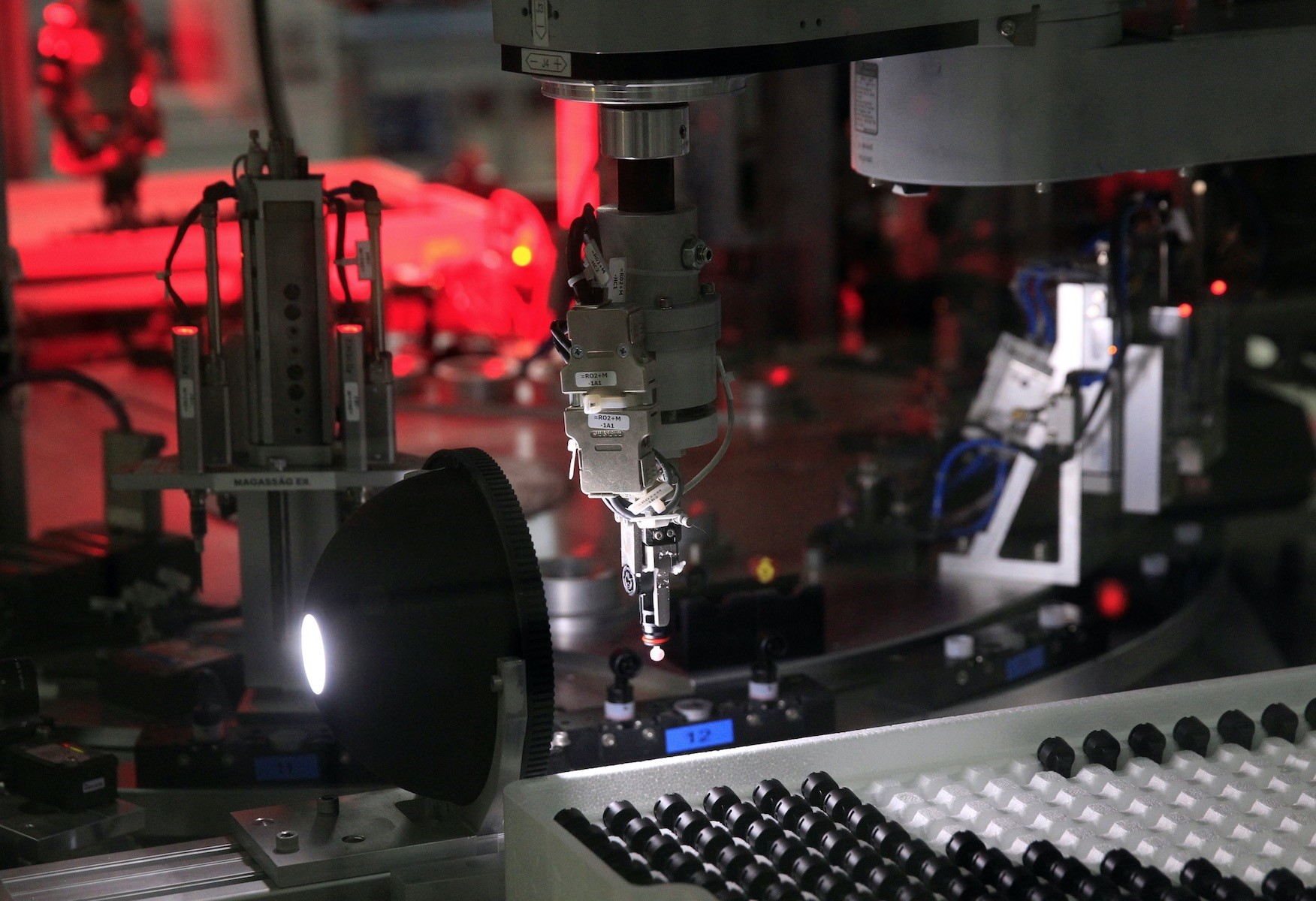 A robot is seen assembling micro gas generators at the Hirtenberger Automotive Safety factory in Papa, Hungary.