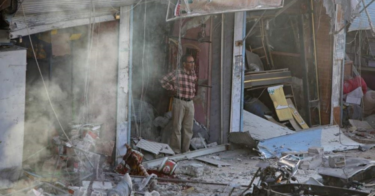 A Syrian man inspects the site of a car bomb explosion in Syria's Tal Abyad, on the border with Turkey, on Nov. 2, 2019. (AFP Photo)