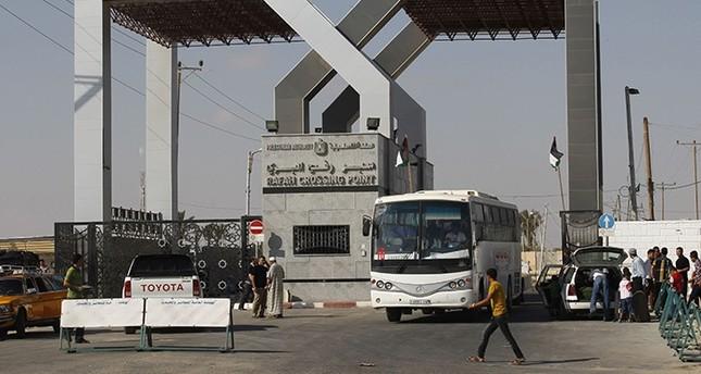 A bus drives through the Rafah border terminal in the southern Gaza Strip on August 24, 2013 (EPA Photo)
