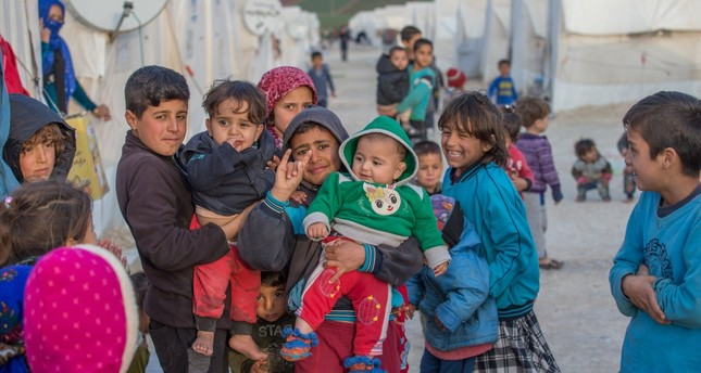 Children of Syrian Kurdish families who escaped from YPG-dominated areas and took refuge in Turkey pose at a camp in the southern province of Şanlıurfa, Dec. 3.