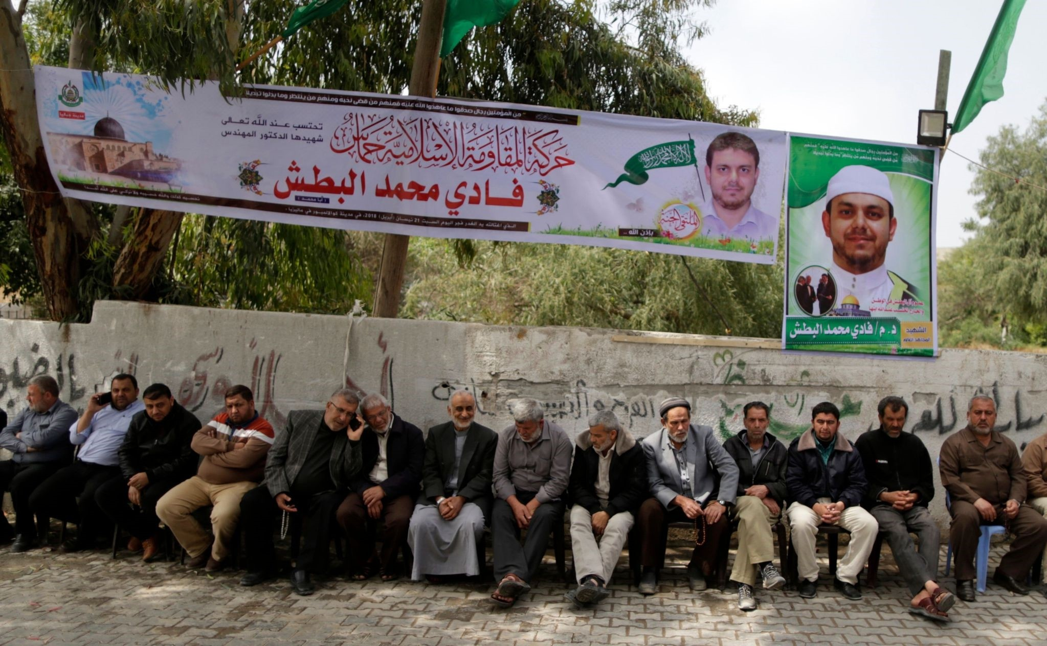 Palestinians gather in mourning outside the family home of 35-year-old professor and Hamas member Fadi Mohammad al-Batsh, who was killed early in the day in Malaysia, in Jabalia in the northern Gaza strip. (AFP Photo)