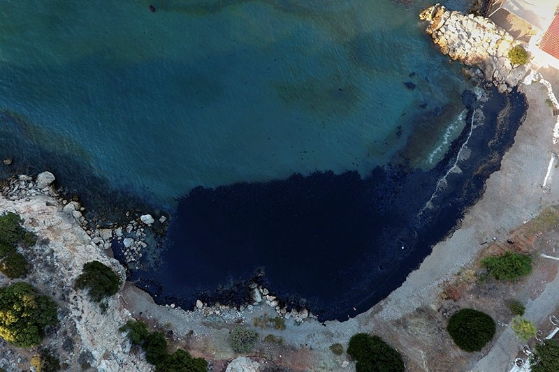 Oil that leaked from a small oil tanker that sank on September 10, is seen on a beach on Salamina island, Greece, September 12, 2017. (Reuters Photo)