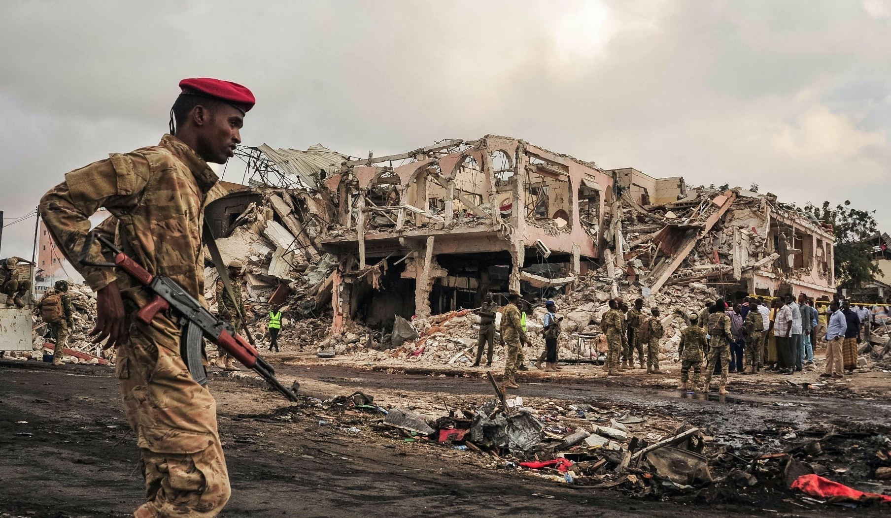 Somali soldiers patrol on the scene of a truck bomb explosu0131on in Mogadishu on October 15, 2017.