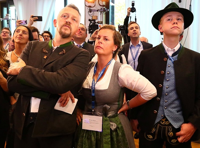 Members of the Christian Social Union Party (CSU) react after the announcement of first exit polls in the Bavarian state elections in Munich, Germany, Oct. 14, 2018. (Reuters Photo)