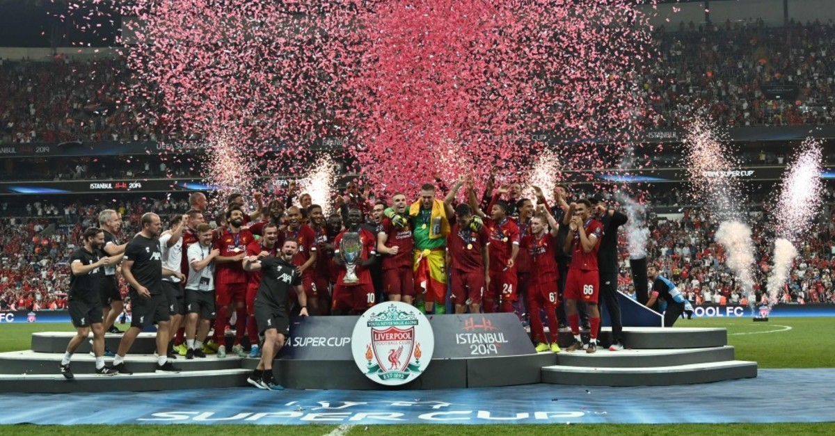 Liverpool's team poses with the trophy after winning the UEFA Super Cup 2019 football match between FC Liverpool and FC Chelsea at Beu015fiktau015f's Vodafone Park stadium, Istanbul, Aug. 14, 2019.