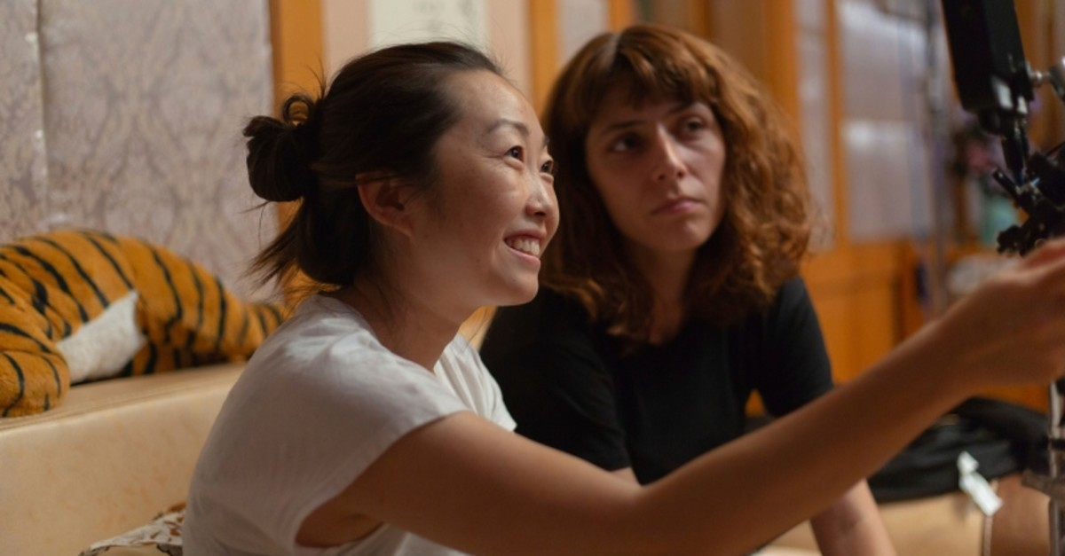 This image released by A24 shows director Lulu Wang, left, on the set of ,The Farewell., Women directed 12 of 2019u2019s top 100-grossing films in 2019 (Casi Moss/A24 via AP)