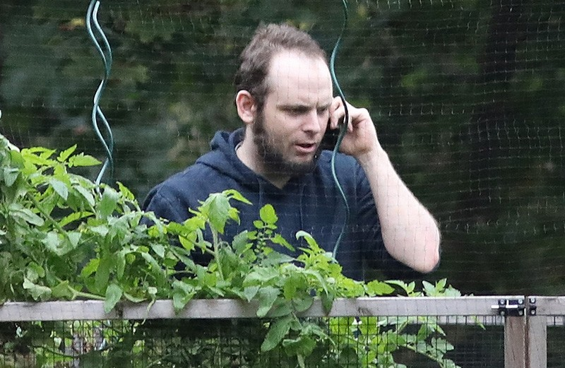 This file photo taken on October 14, 2017 shows freed Canadian hostage Joshua Boyle talking on the phone outside the Boyle family home in Smiths Falls, Ontario, Canada (AFP Photo)