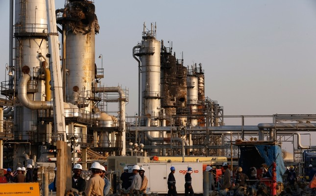During a trip organized by Saudi information ministry, workers fix the damage in Aramco's oil processing facility after the recent Sept. 14 attack in Abqaiq, near Dammam in the Kingdom's Eastern Province, Friday, Sept. 20, 2019. AP Photo