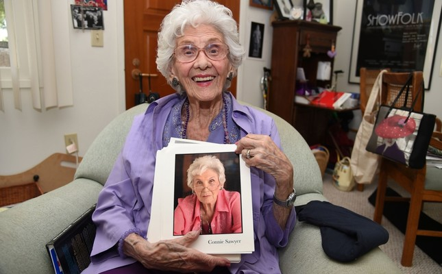 Working actress Connie Sawyer, 103, displays some of her headshots during an interview with AFP at her home in the retirement community of the Motion Picture Television Fund (MPTF).