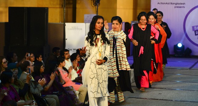Bangladesh acid survivors walk down runway to fight discrimination