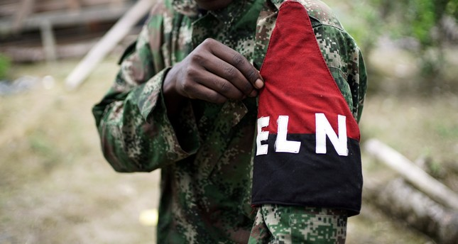 A rebel of Colombia's Marxist National Liberation Army (ELN) shows his armband while posing for a photograph, in the northwestern jungles, Colombia August 31, 2017. Picture taken August 31, 2017. (REUTERS Photo)