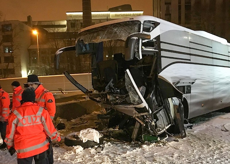 This handout picture released by Swiss police of the Canton of Zurich (Kantonspolizei Zurich) shows the wreckage of a bus that crashed into a wall early on December 16, 2018 on motorway A3 near Zurich, killing 1 and injuring 44. (AFP Photo)
