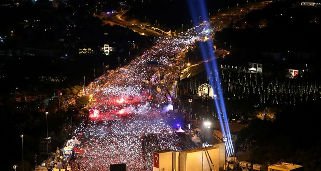 Millions of people wave national flags at the foot of the 'July 15 Martyrs Bridge' to commemorate the first anniversary of the failed coup in Istanbul, July 15.