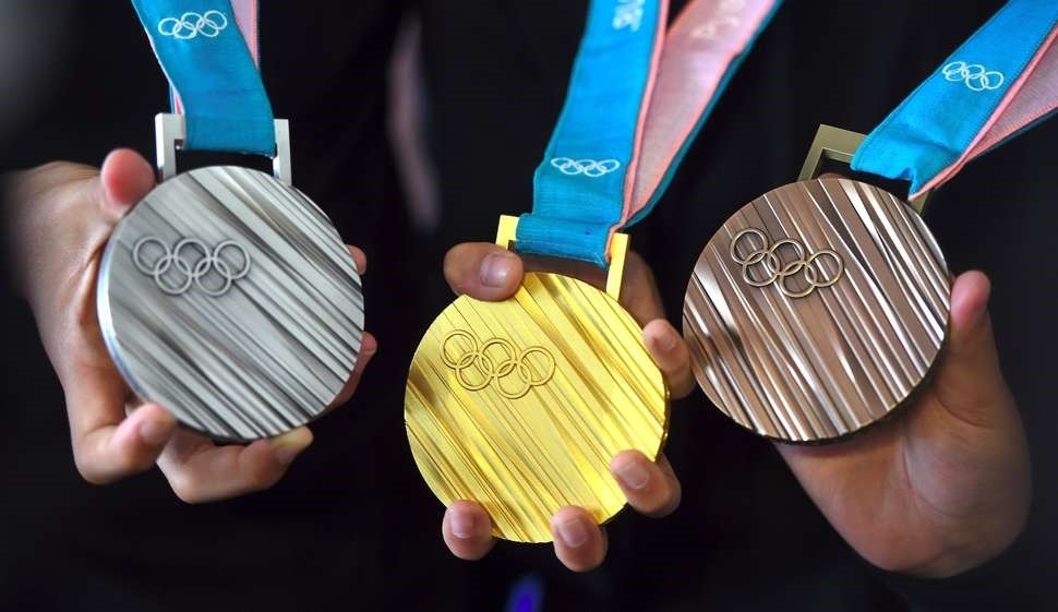 The PyeongChang 2018 Olympic medals are displayed by young South Korean athletes during their unveiling at a ceremony in Seoul on September 21, 2017. (AFP Photo)