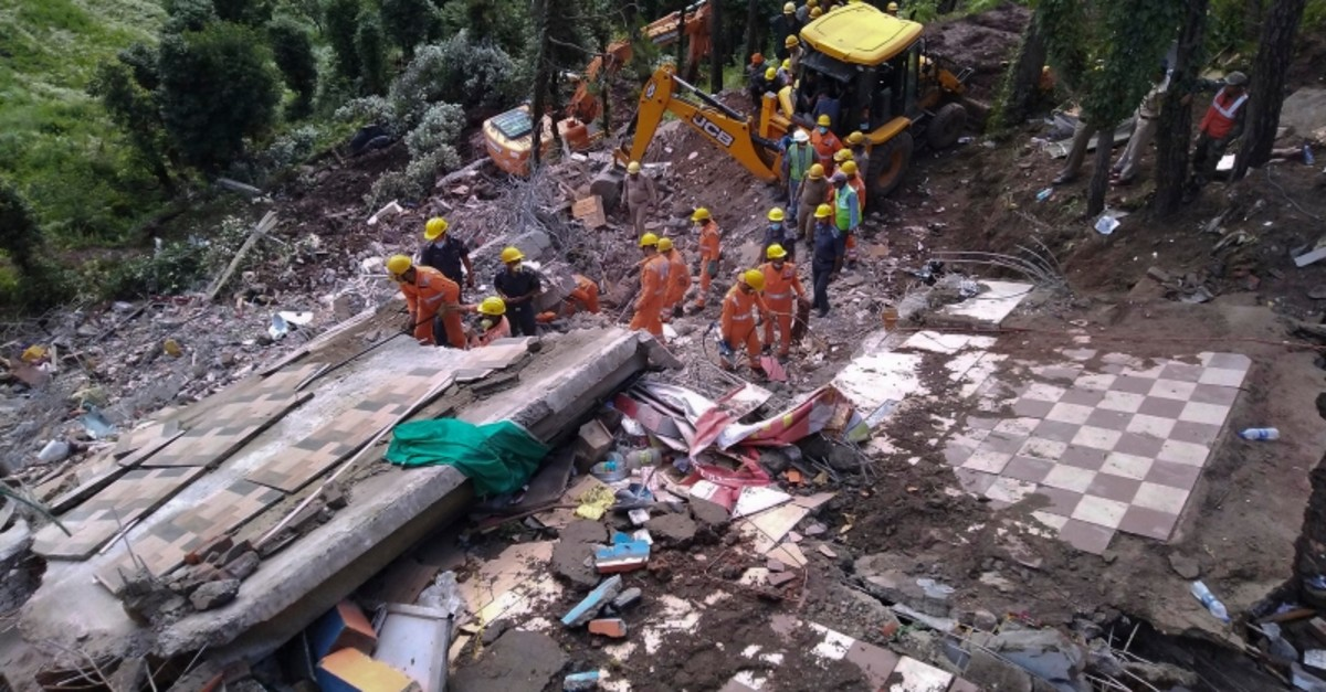 Rescuers of Indiau2019s National Disaster Response Force (NDRF) look for survivors after a three-story building collapsed in monsoon rains near town of Solan, 310 km north of New Delhi, India, July 15, 2019. (AP Photo)