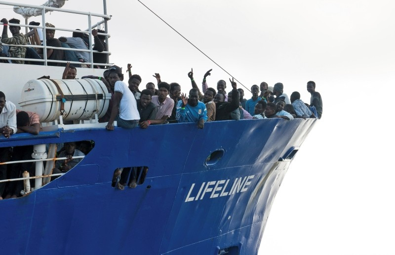 In this photo taken on Thursday, June 21, 2018, migrants wave from aboard ship operated by the German NGO Mission Lifeline. (AP Photo)
