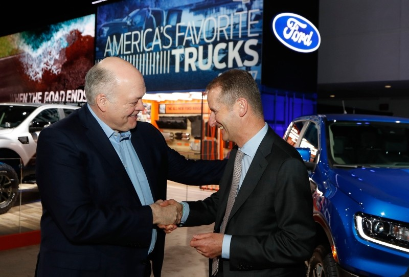 Ford Motor Co. President and CEO, Jim Hackett, left, meets with Dr. Herbert Diess, CEO of Volkswagen AG, Monday, Jan. 14, 2019, at the North American International Auto Show in Detroit. (AP Photo)