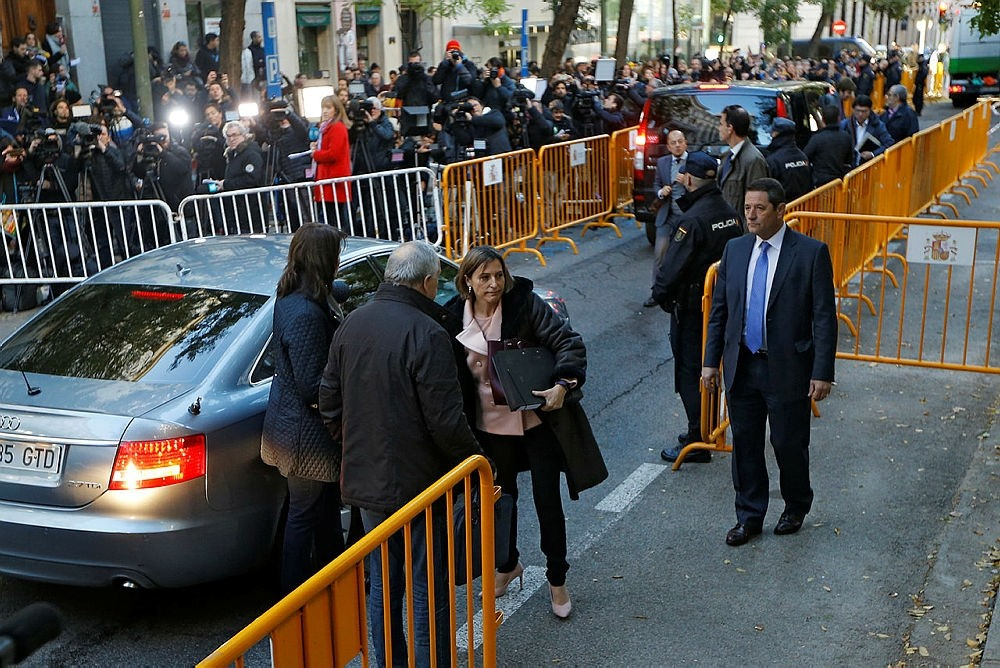 Ex-speaker of the Catalonia parliament Carme Forcadell, center, arrives at the Supreme Court in Madrid, Thursday, Nov. 9, 2017. (AP Photo)