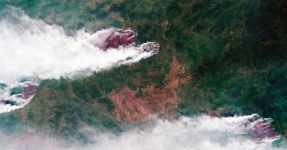 This satellite image provided by Roscosmos Space Agency, taken on Sunday, July 21, 2019, shows forest fires in Krasnoyarsk region, Eastern Siberia, Russia. (Roscosmos Space Agency via AP)