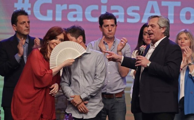 Argentina's president elect Alberto Fernandez, right, delivers a speech next to running mate, former President Cristina Fernández, left, in Buenos Aires, Argentina, Sunday, Oct. 27, 2019. (AFP Photo)