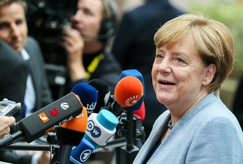German Chancellor Angela Merkel answers to journalists' questions as she arrives on the first day of the European Council Meeting in Brussels, Oct. 19, 2017 (EPA Photo)