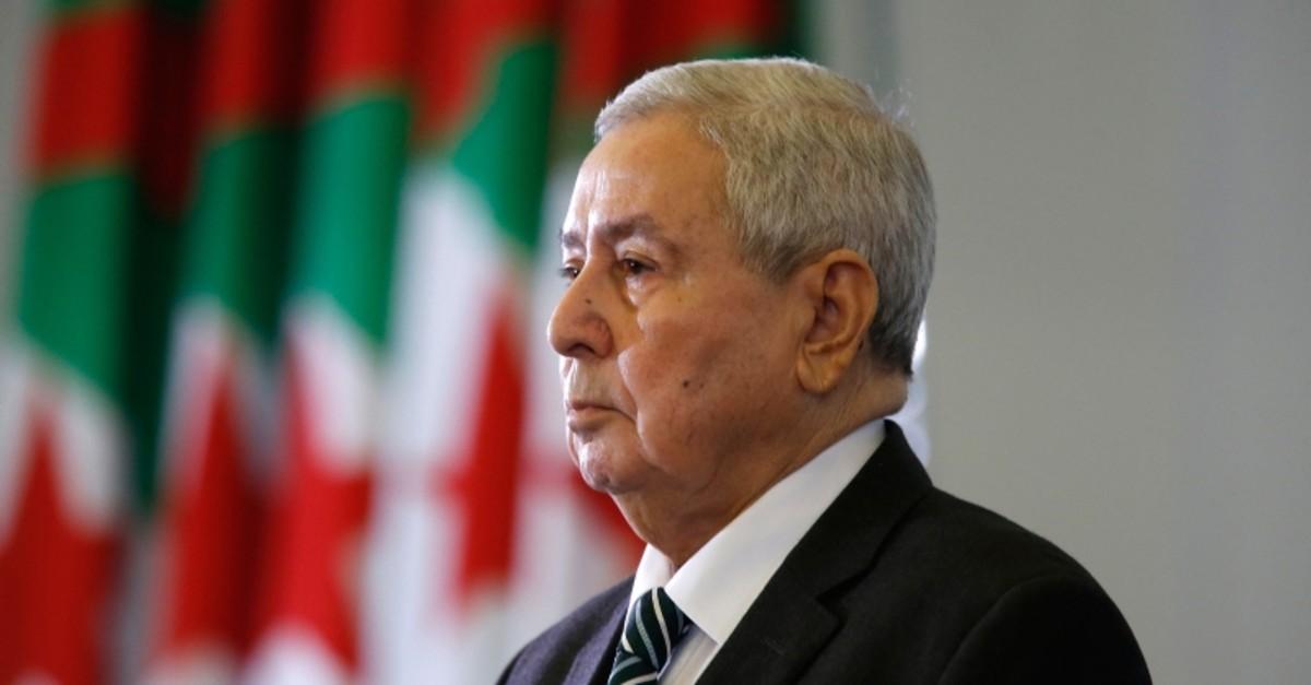 Abdelkader Bensalah stands while being named interim leader to replace former Algerian President Abdelaziz Bouteflika, in Algiers, Tuesday, April 9, 2019. (AP Photo)