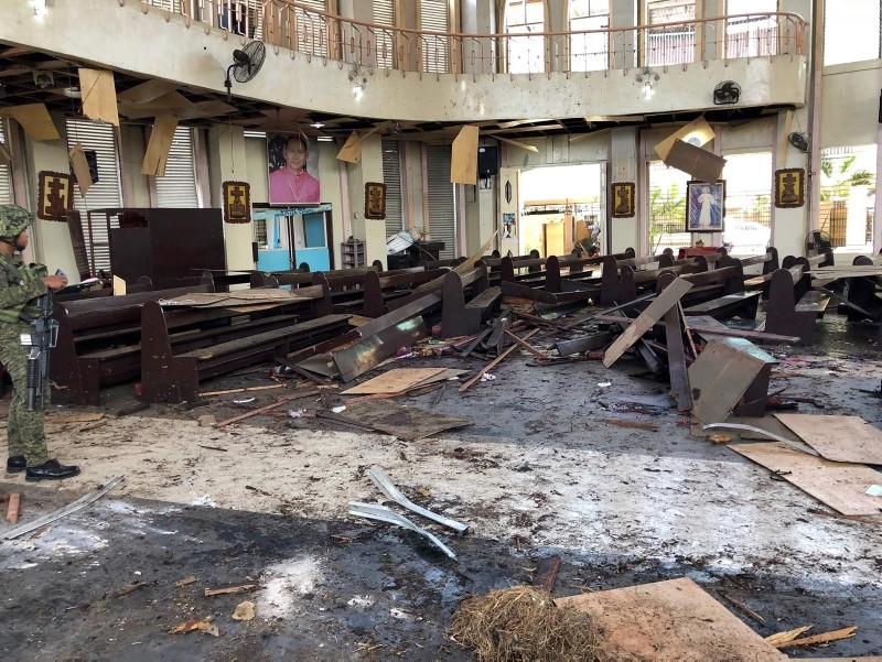 This handout photo released by Armed Forces of the Philippines Public Information Office Western Mindanao Command (WESTMINCON) shows debris inside a church where 2 bombs exploded in Jolo, Sulu province on the southern island of Mindanao. (AFP Photo)