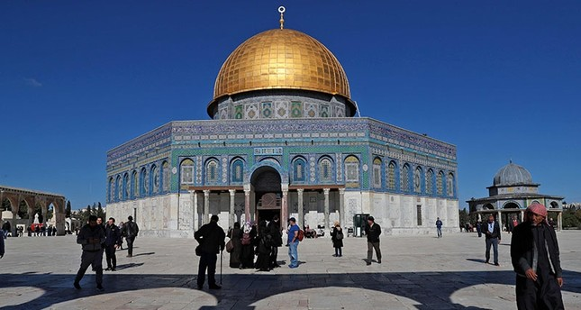 Palestinian Muslim worshipers walk in front of the Dome of the Rock mosque at the Al Aqsa mosque compound in the Jerusalem's Old City on Dec. 8, 2017. AFP Photo