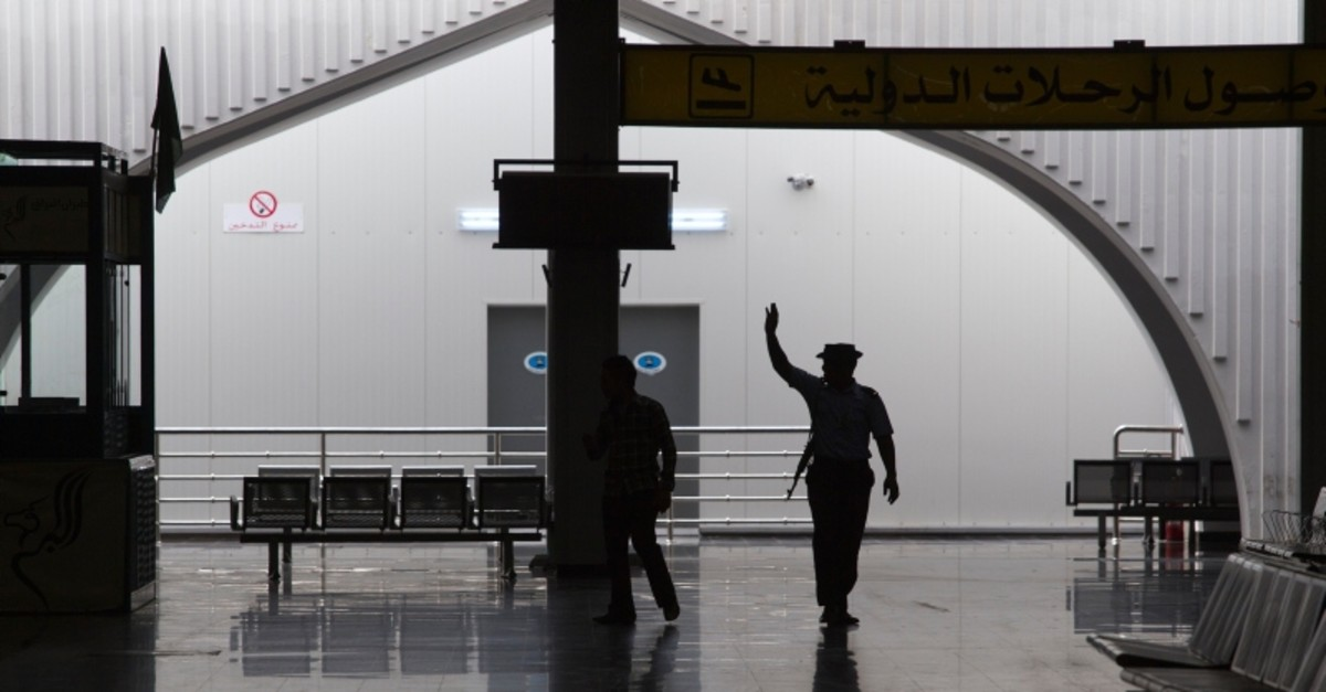 In this Aug. 20, 2011, file photo taken on a government-organized tour, a guard waves to fellow officers in the main lobby of the international airport in Tripoli, Libya. (AP Photo)