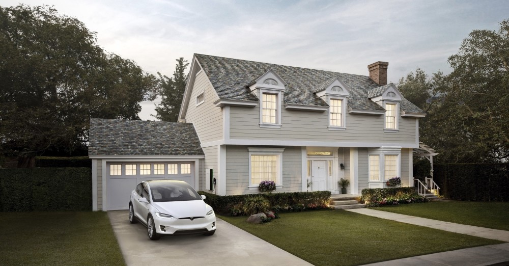 This photo provided by Tesla shows a house with Teslau2019s new slate solar roof tiles. As of Wednesday, customers worldwide could order a solar roof on Teslau2019s website.